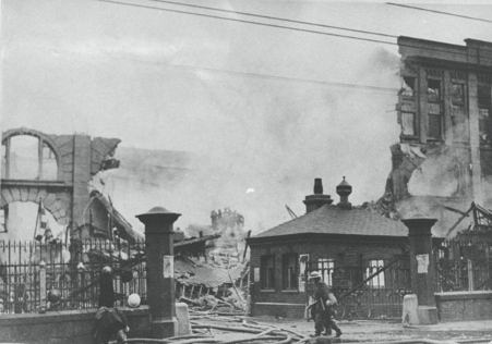 Firemen outside the entrance to New Bridge Street Goods Station the morning after Second World War German bombing