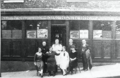 People posing outside New Hawk Inn