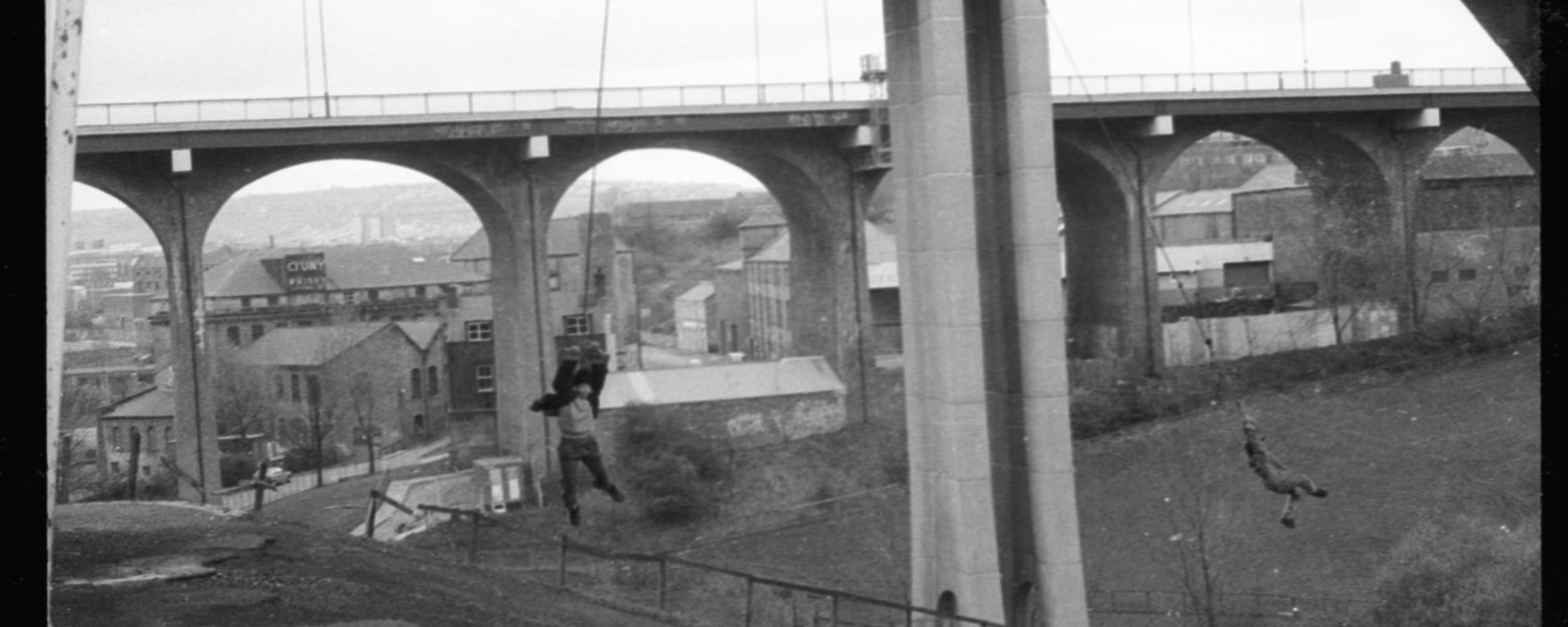 boys swinging from Ouseburn viaduct