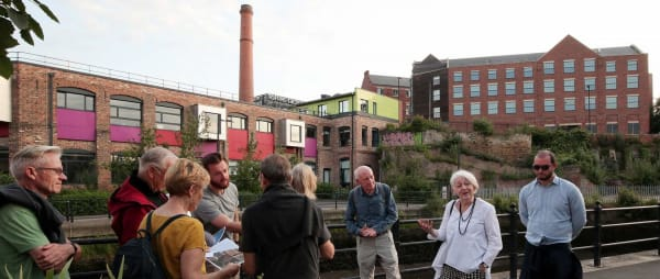 People discussing Ouseburn in front of Toffee Factory