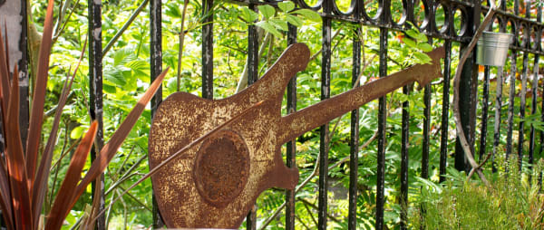 Photo of metal guitar art outside of the Cumberland Arms