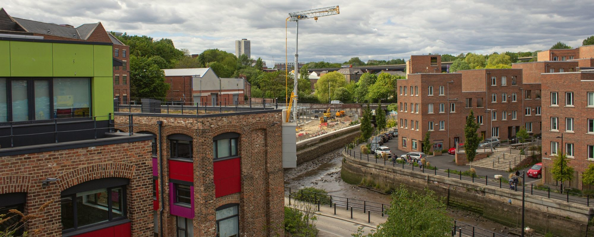 Photo of Ouseburn from glasshouse bridge which shows the Toffee Factory and the Mallings development